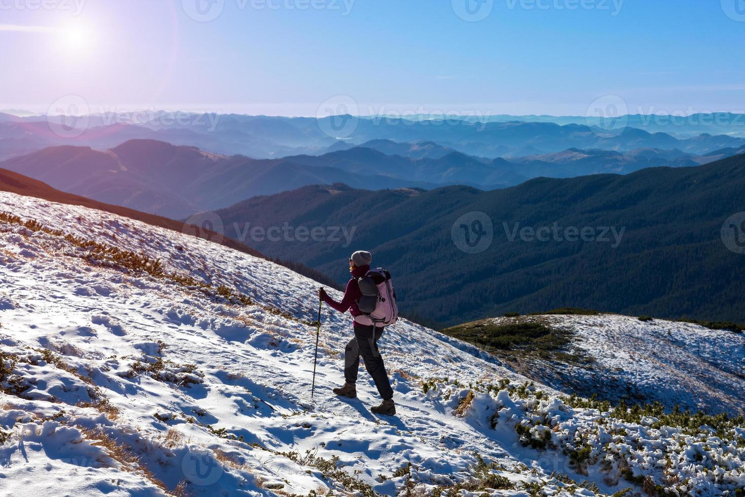 One Hiker Walking on Snow Ice Terrain Wide Mountain View photo