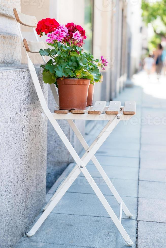 Chair with flowers photo