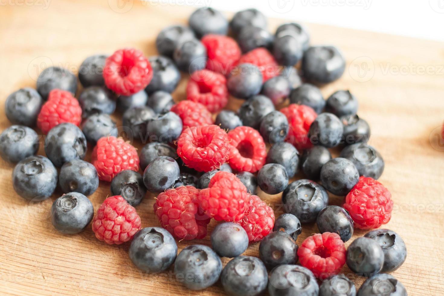 Heart of juicy ripe berries blueberries and raspberries photo