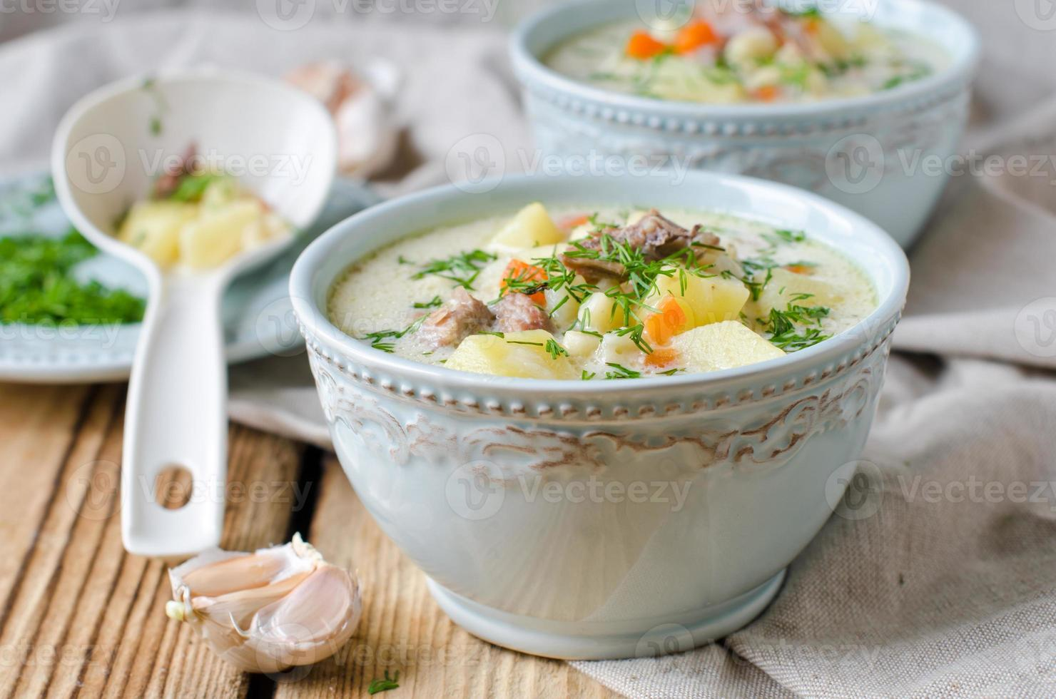 Cheese soup with chicken and vegetables photo