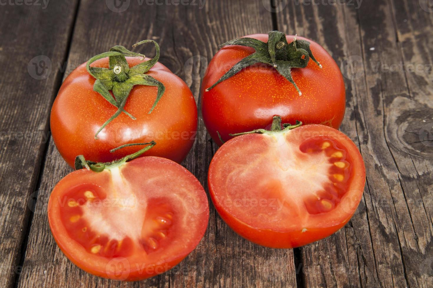 Tomatoes on a wooden table photo