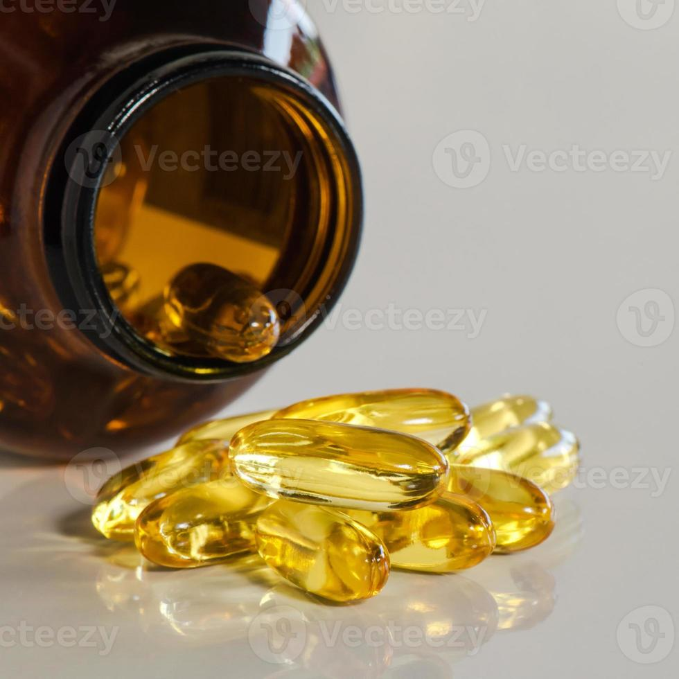 Fish oil capsules and container photo