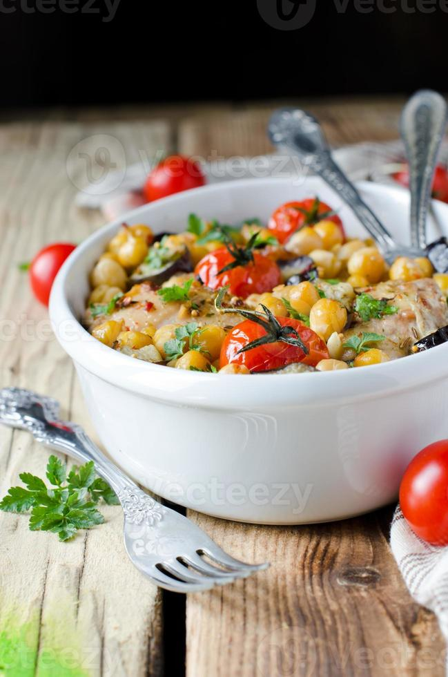 Baked chicken with chickpeas and vegetables photo