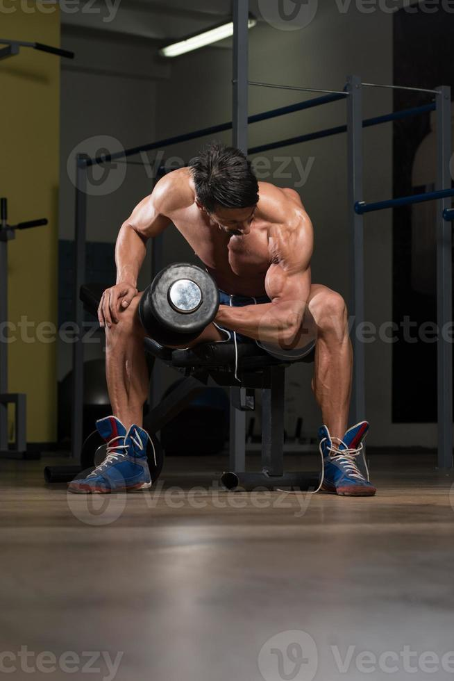 Fit Athlete Exercise With Dumbbells photo