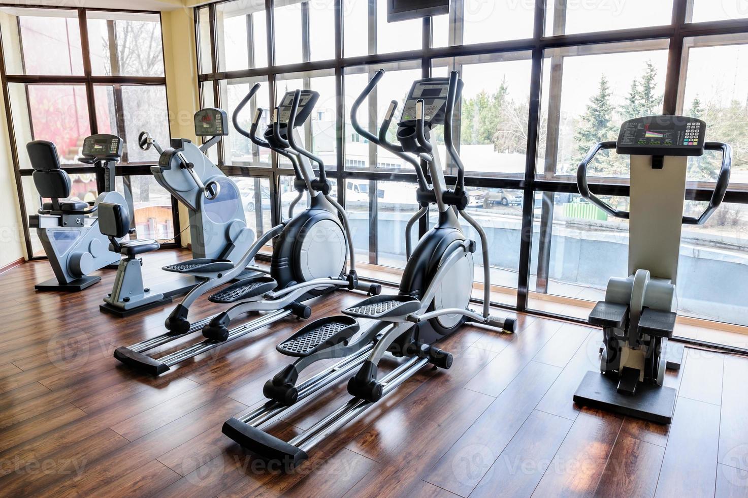 Gym interior with many treadmill machines photo