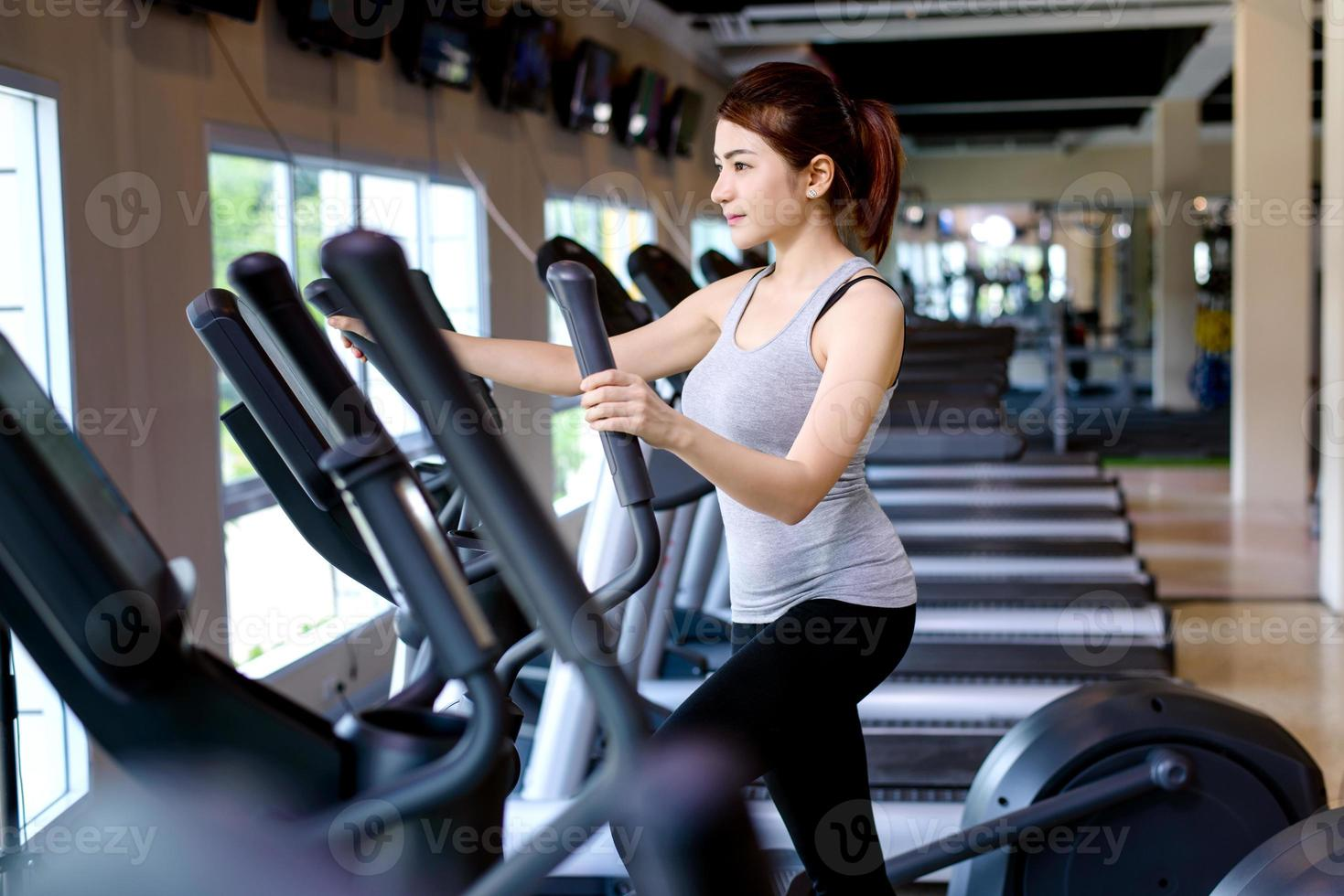 Fitness Young women are exercising by running on the treadmill. photo