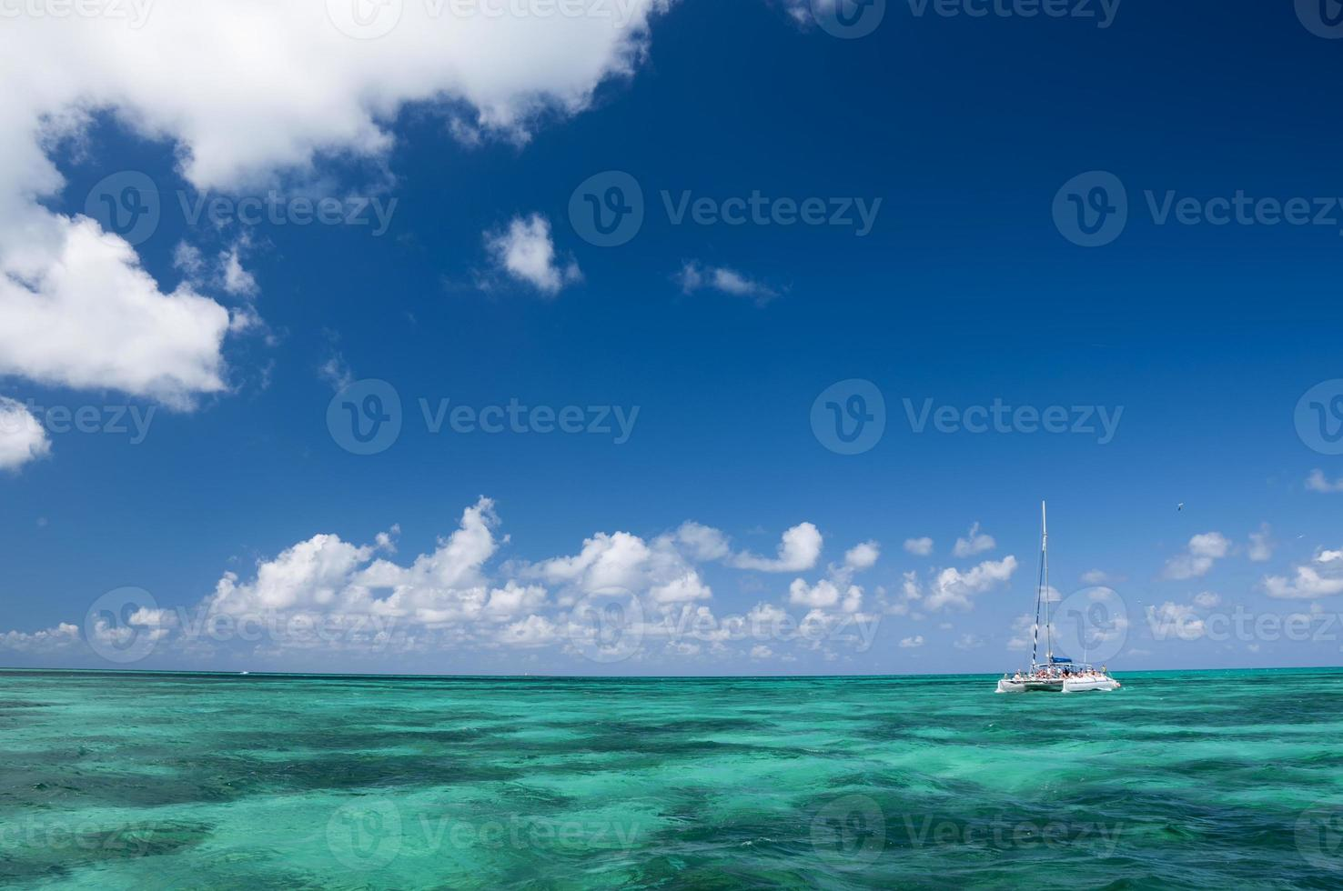 White catamaran with tourists photo
