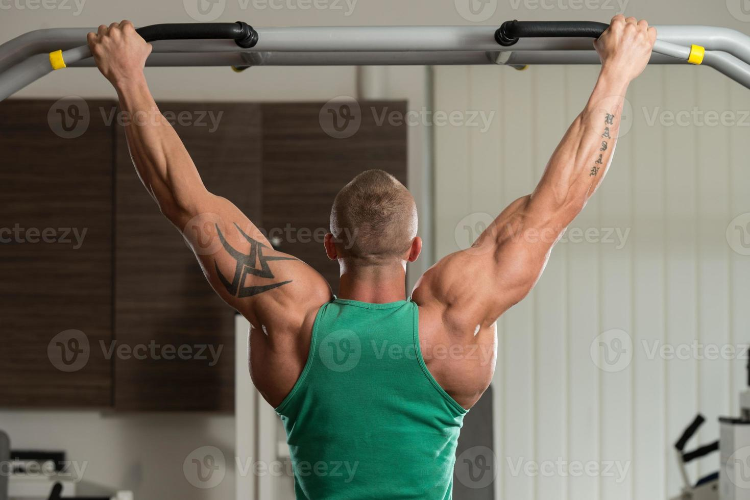 Bodybuilder Doing Pull Ups Best Back Exercises photo