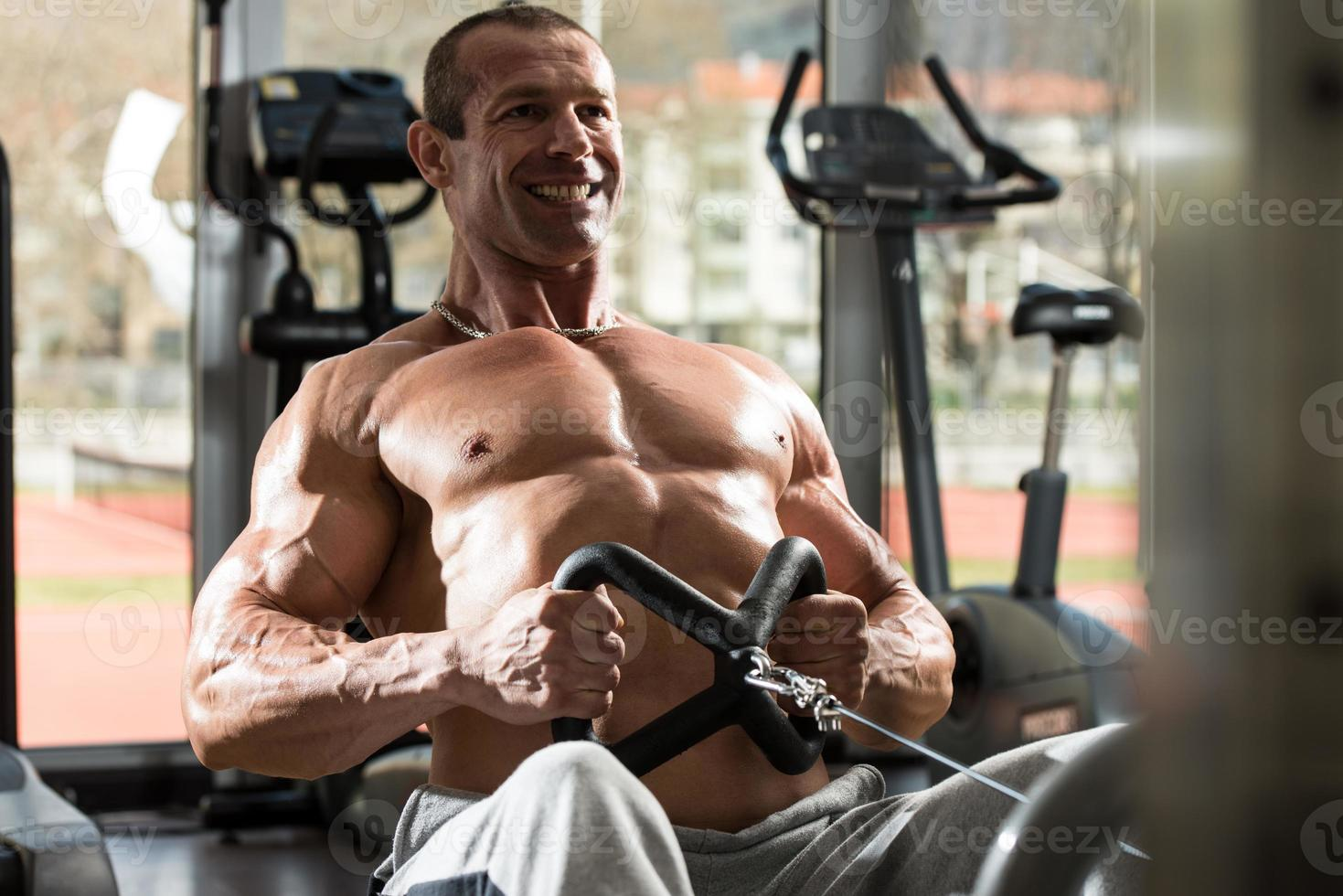 Back Exercises On A Seated Row Machine photo