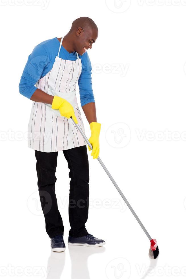 african american man sweeping photo