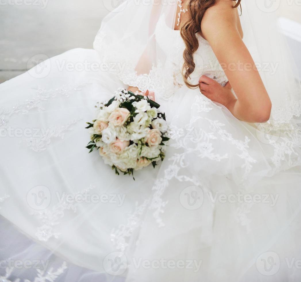 Gorgeous caucasian bride in beautiful dress photo