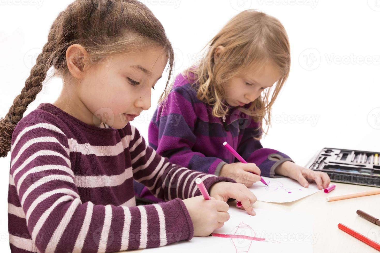 Two drawing baby girls, Asian and Caucasian photo