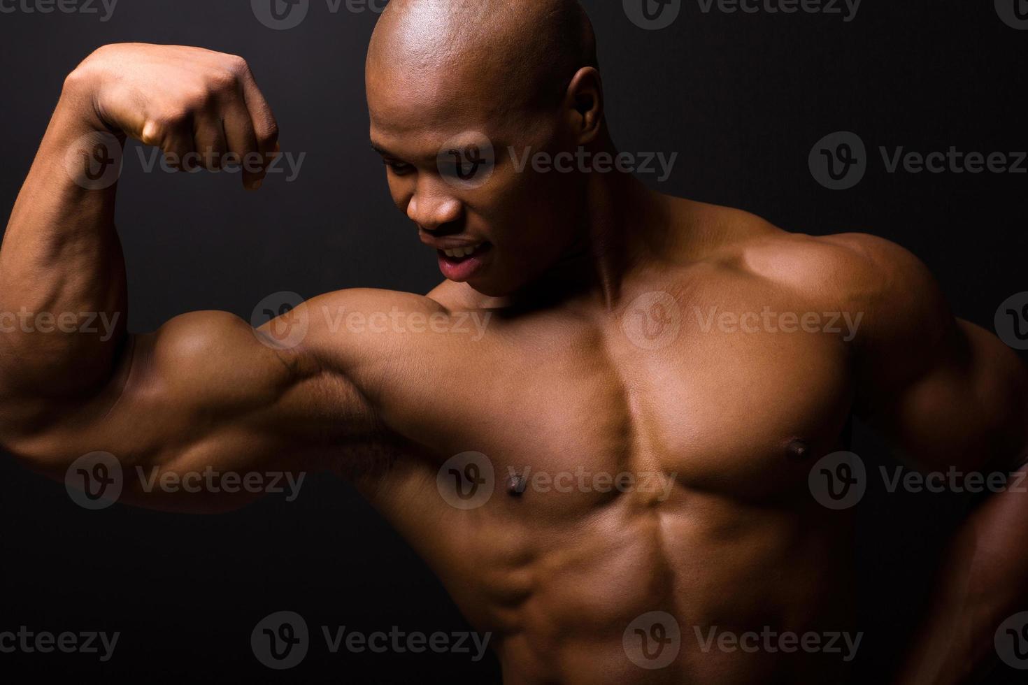 african bodybuilder on black background photo