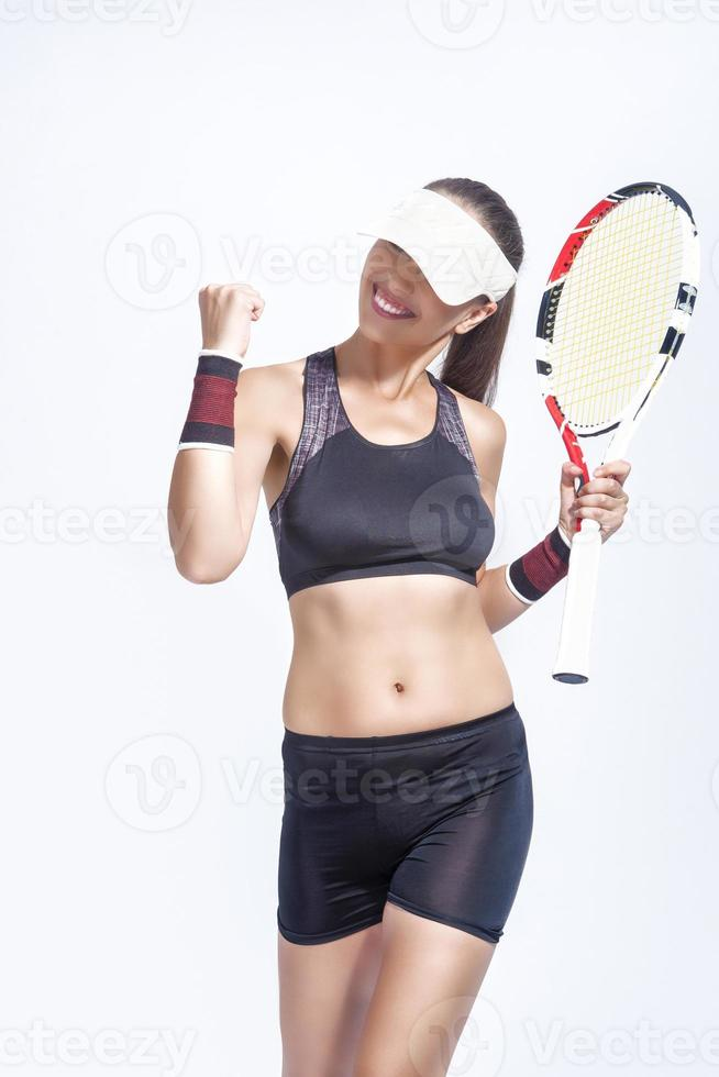 Professional Caucasian Tennis Player Excited With Racket showing emotional Exclamation. photo