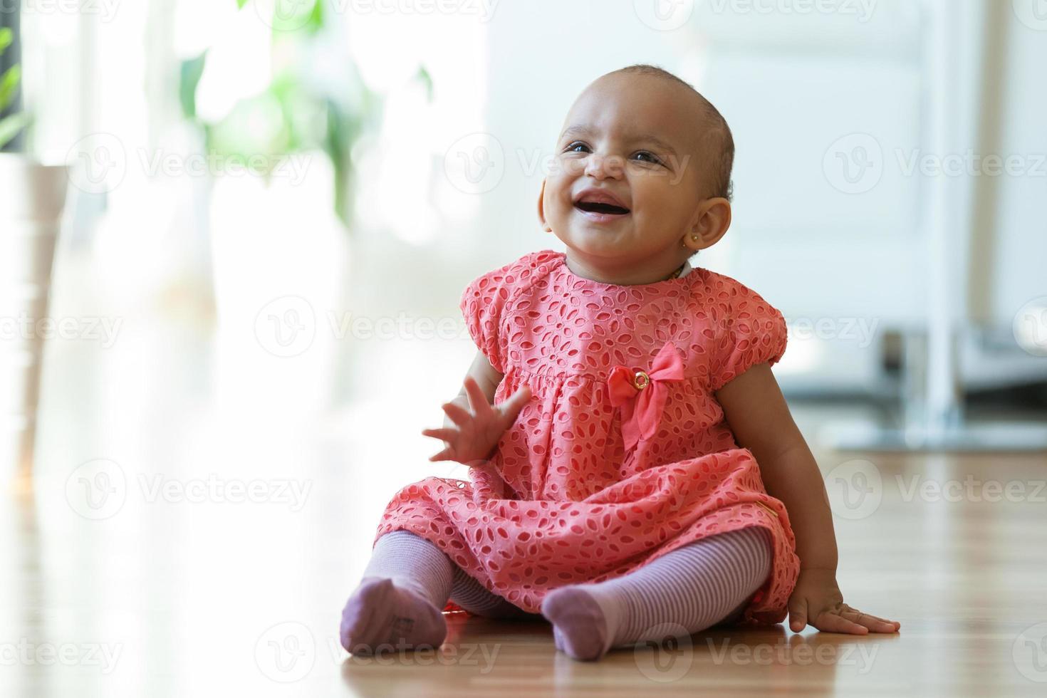 Portrait of little African American little girl sitting photo