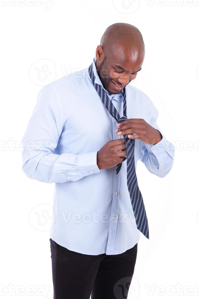 African American business man knotting a tie photo