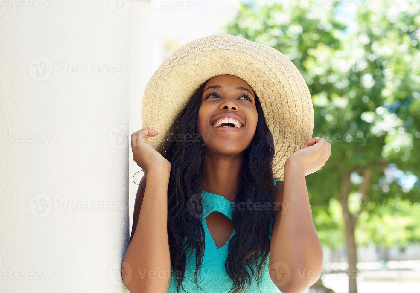 Smiling african american model with sun hat photo