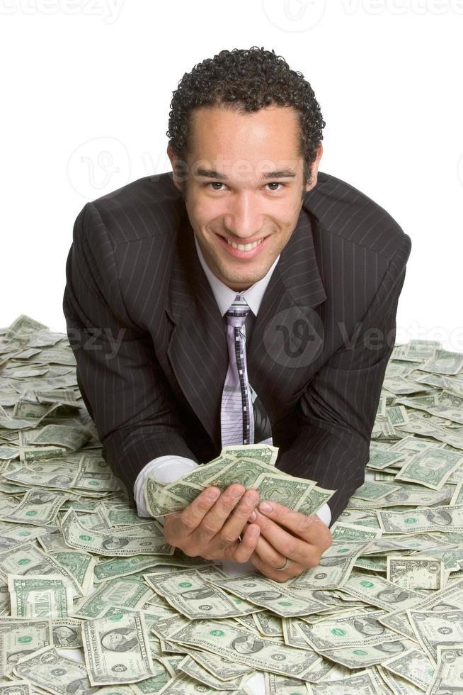 Businessman laying in cash photo