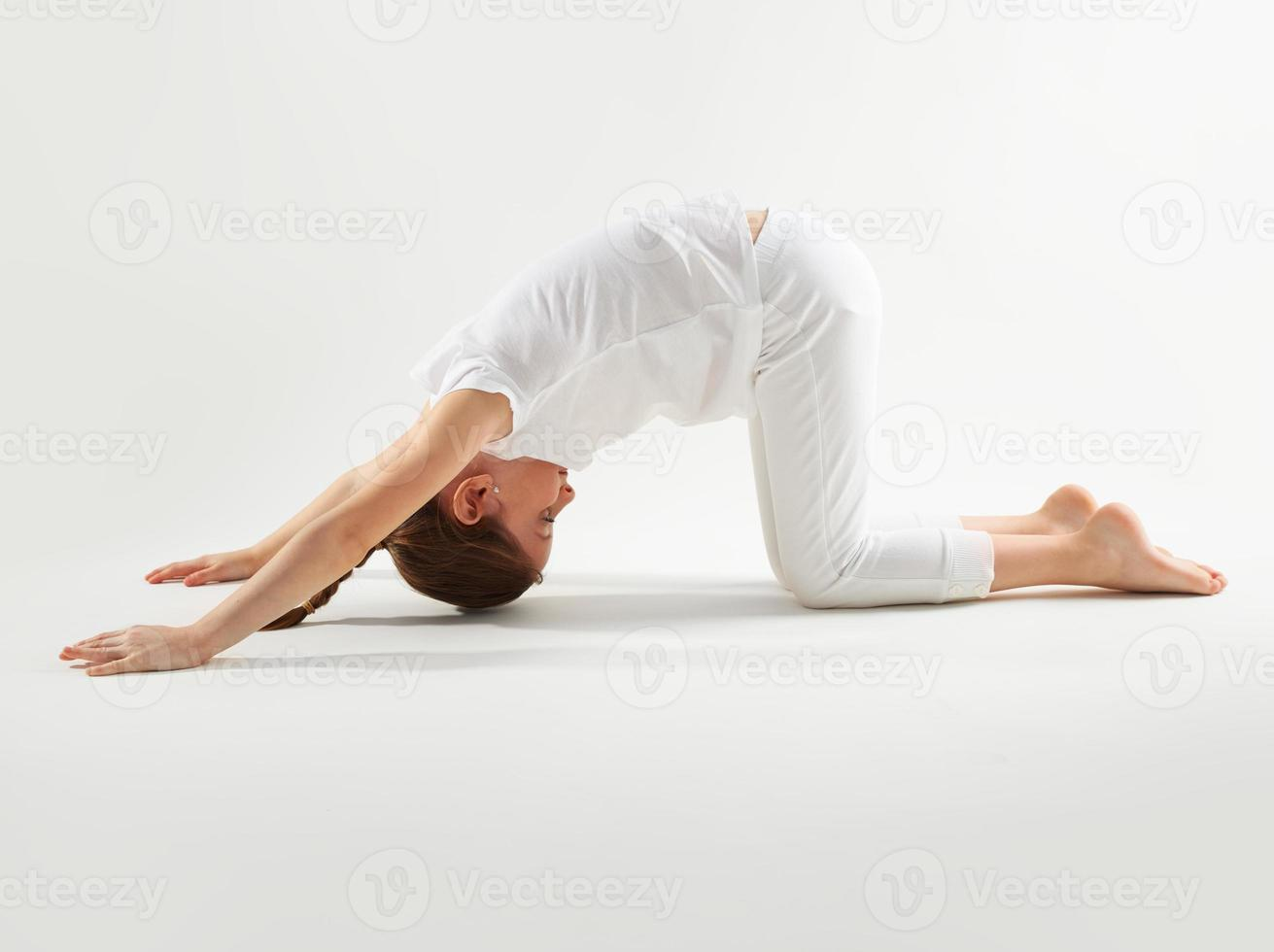 Young girl doing yoga photo