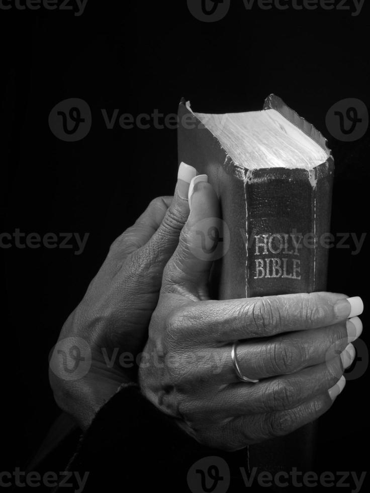 Christian Grasping Bible photo