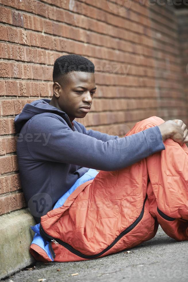 Vulnerable Teenage Boy Sleeping On The Street photo