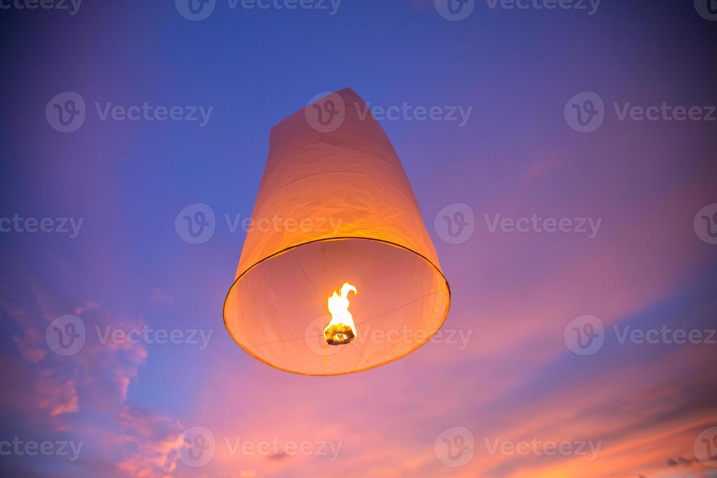 Floating lanterns in the evening sky photo