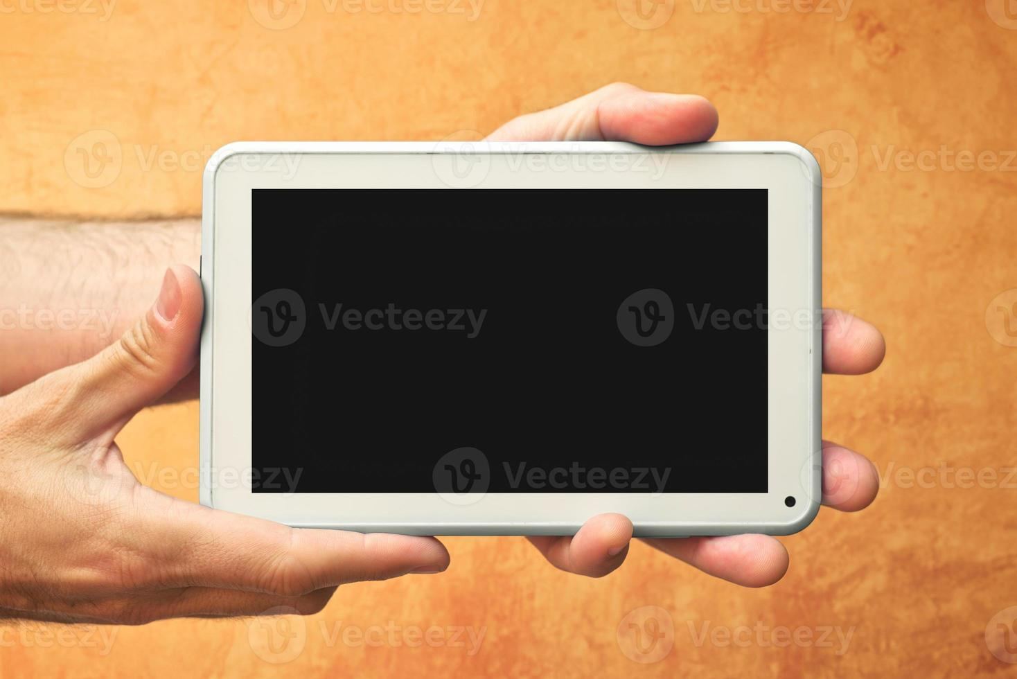 Hands with tablet computer photo