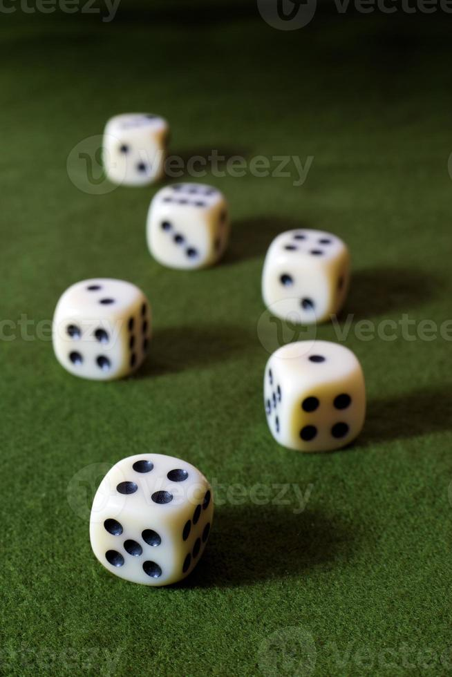 White Dices on Green Table photo