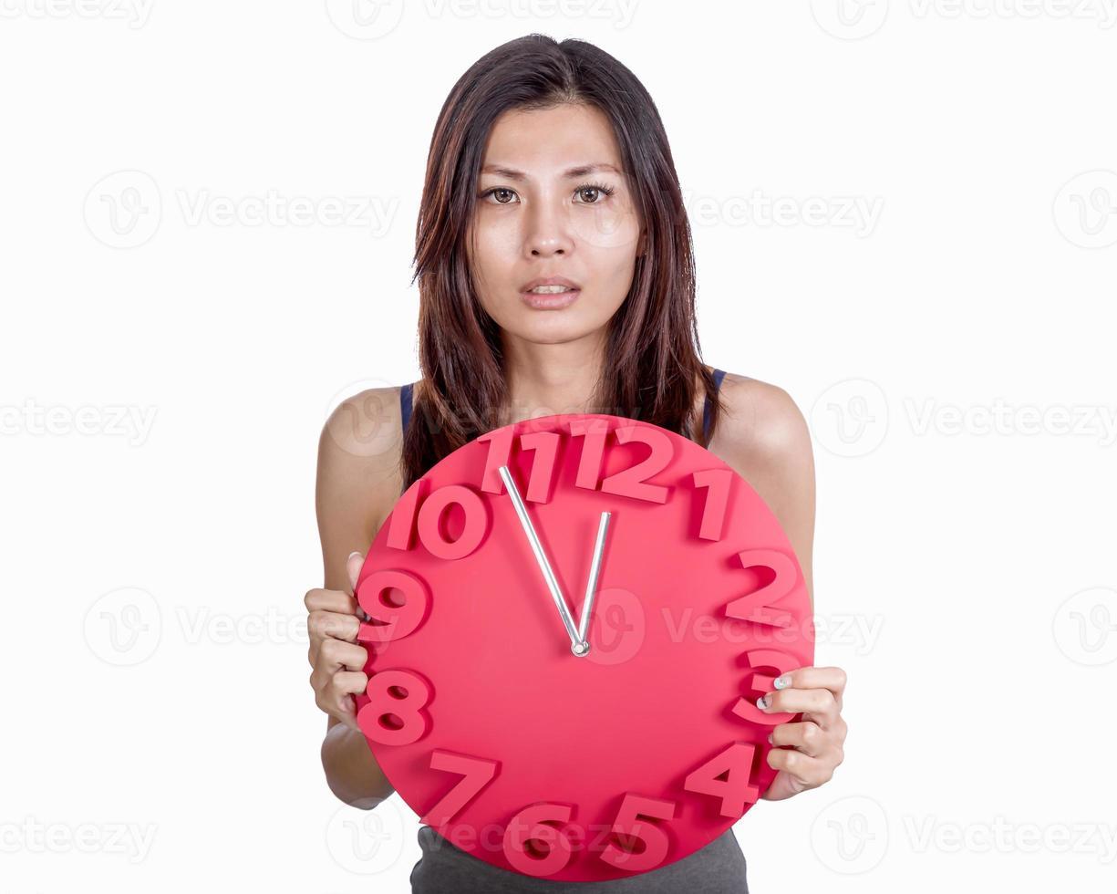 Asian woman holding clock photo
