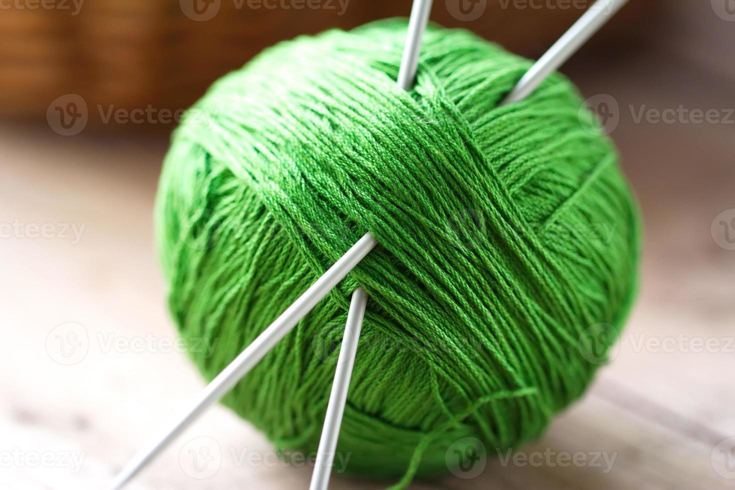Clew of yarn with needles for knitting photo