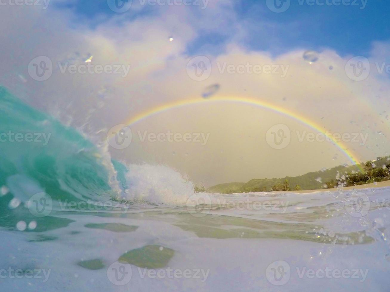 Barrel and a rainbow with water droplets photo