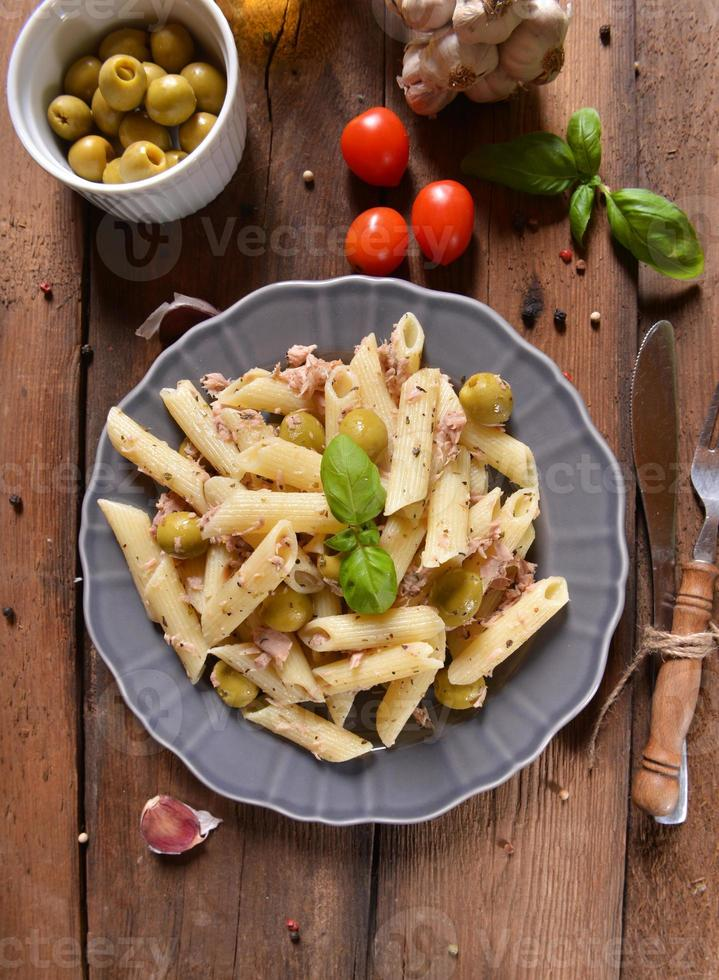 Pasta with tuna and green olives photo