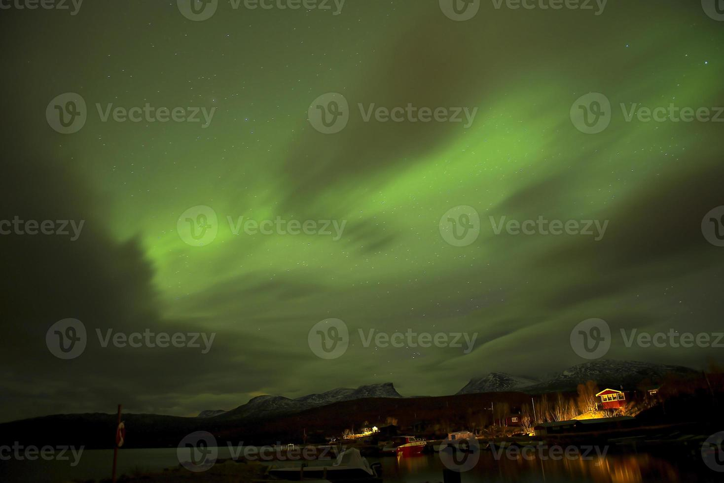Northern Lights with adventure the cold at Abisko, Sweden. photo