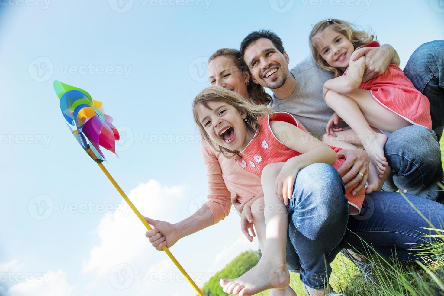 Happy family with twin girls photo