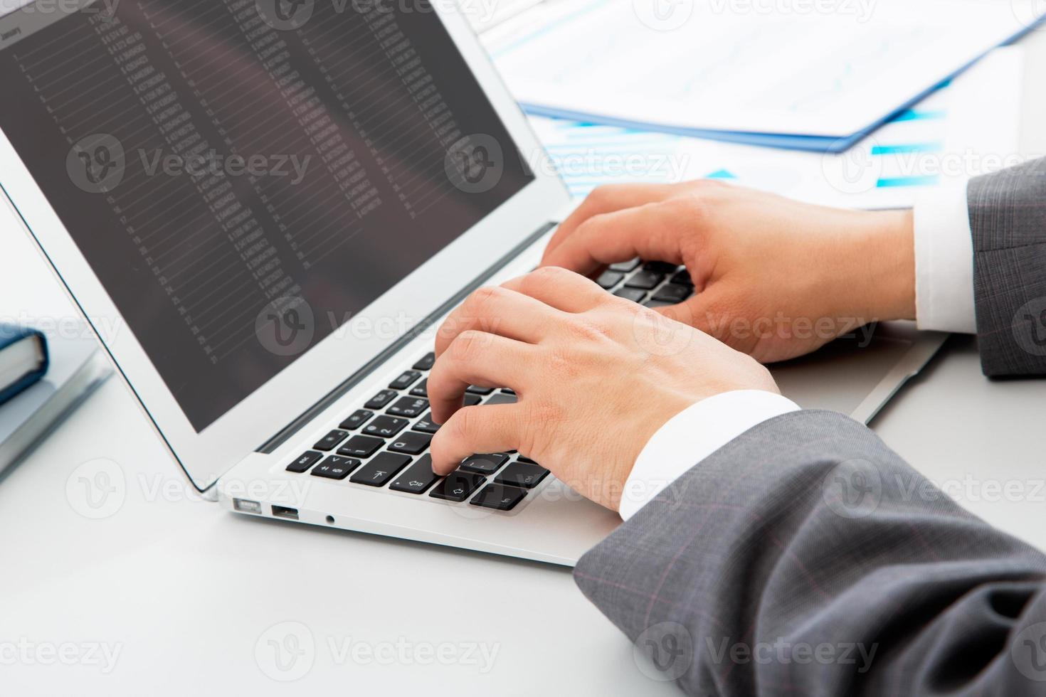 Close-up image of typing male hands photo
