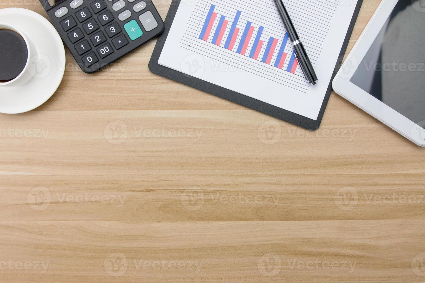 Office supplies on the wooden desk photo