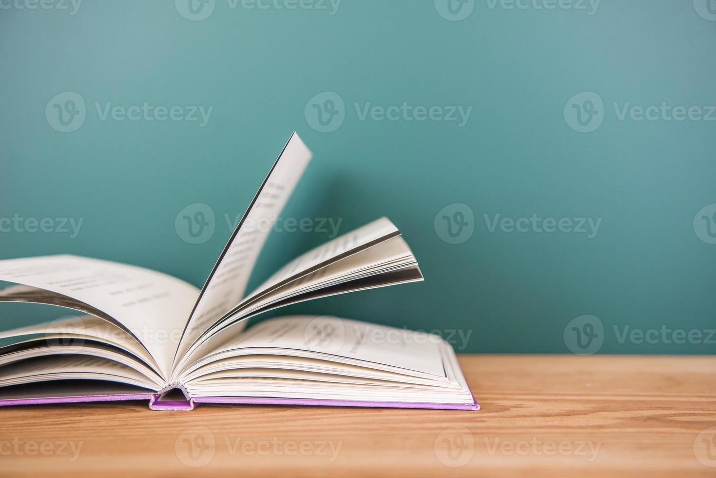 School books on desk, education concept photo
