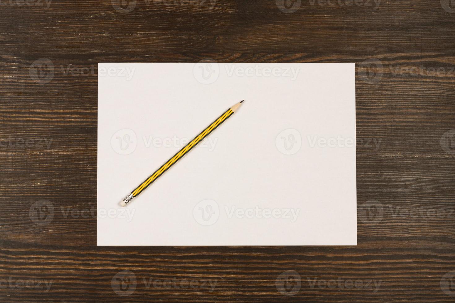 White card on wooden desk photo