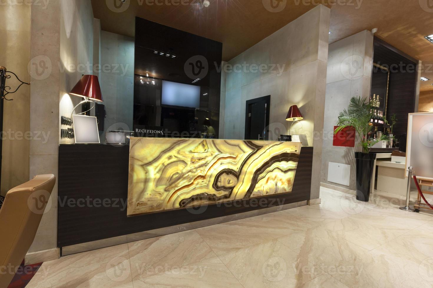 Glowing marble reception desk photo