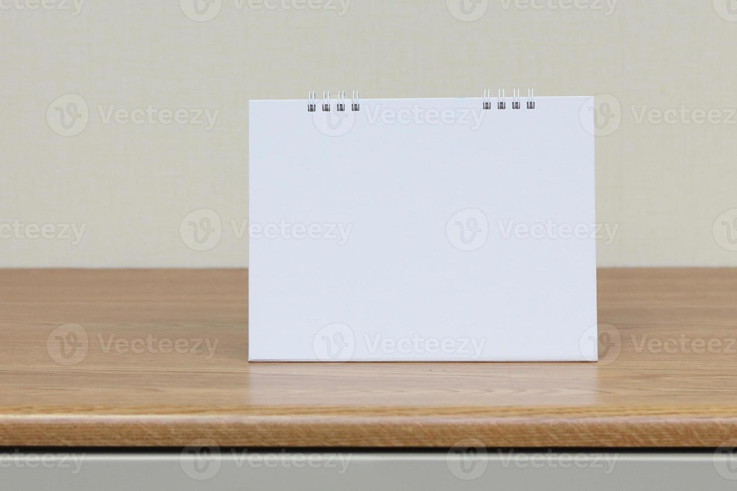 blank paper desk spiral calendar photo