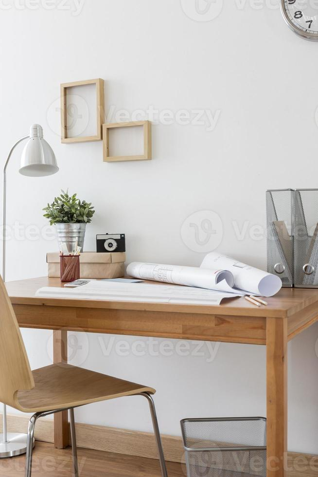 Simple wooden desk and chair photo