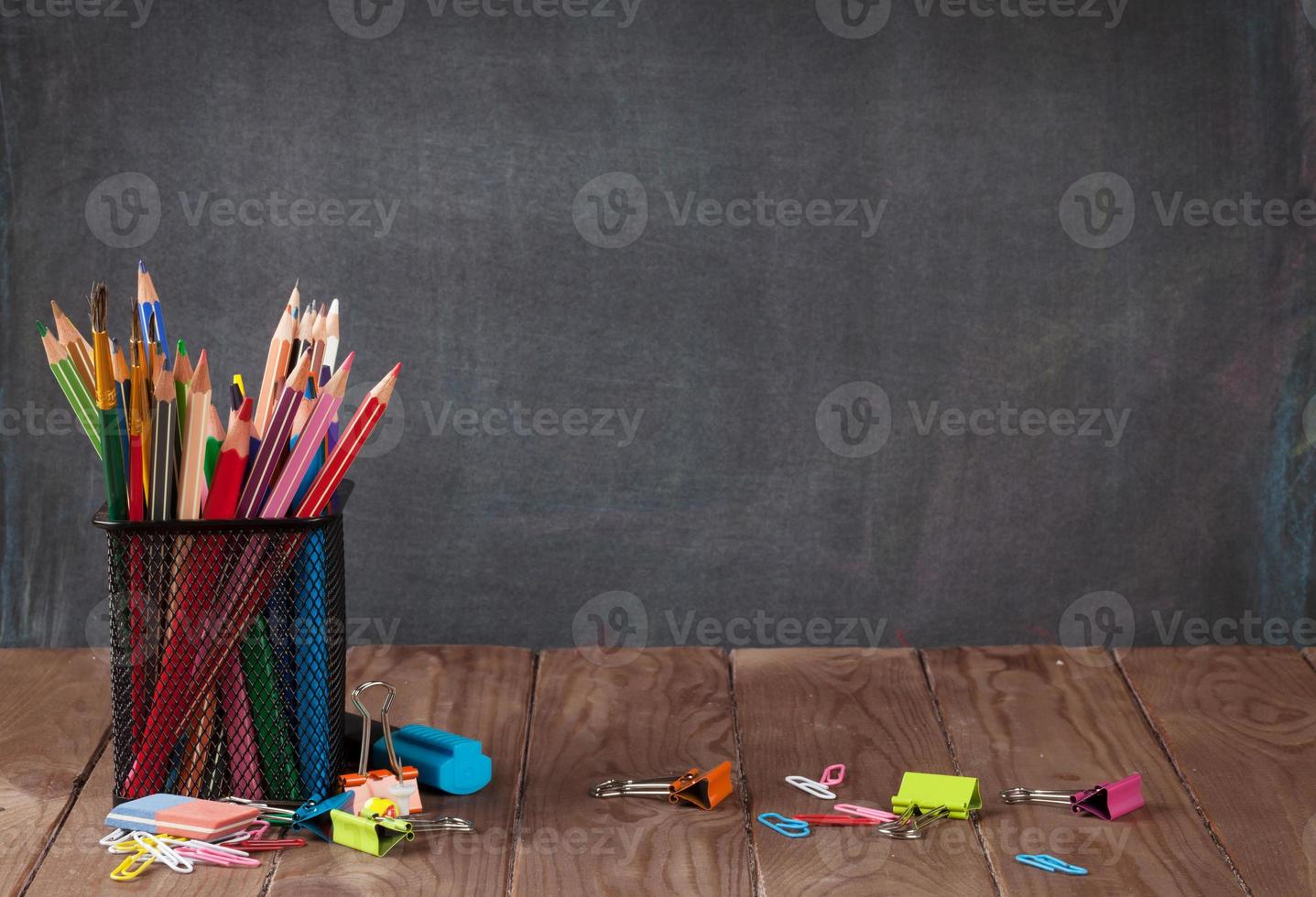School and office supplies on classroom table photo
