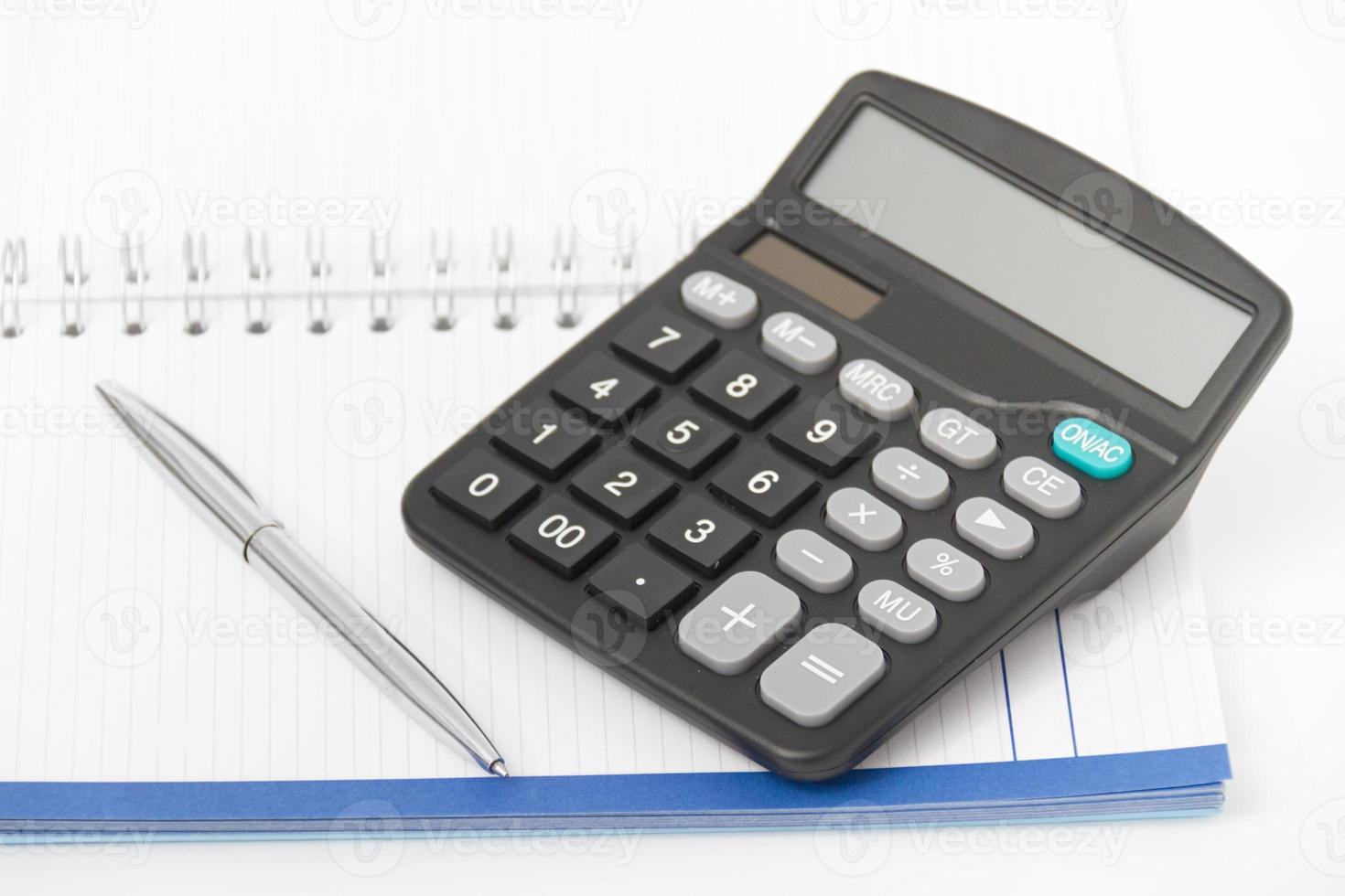 Business concept with calculator, pen and notebook photo
