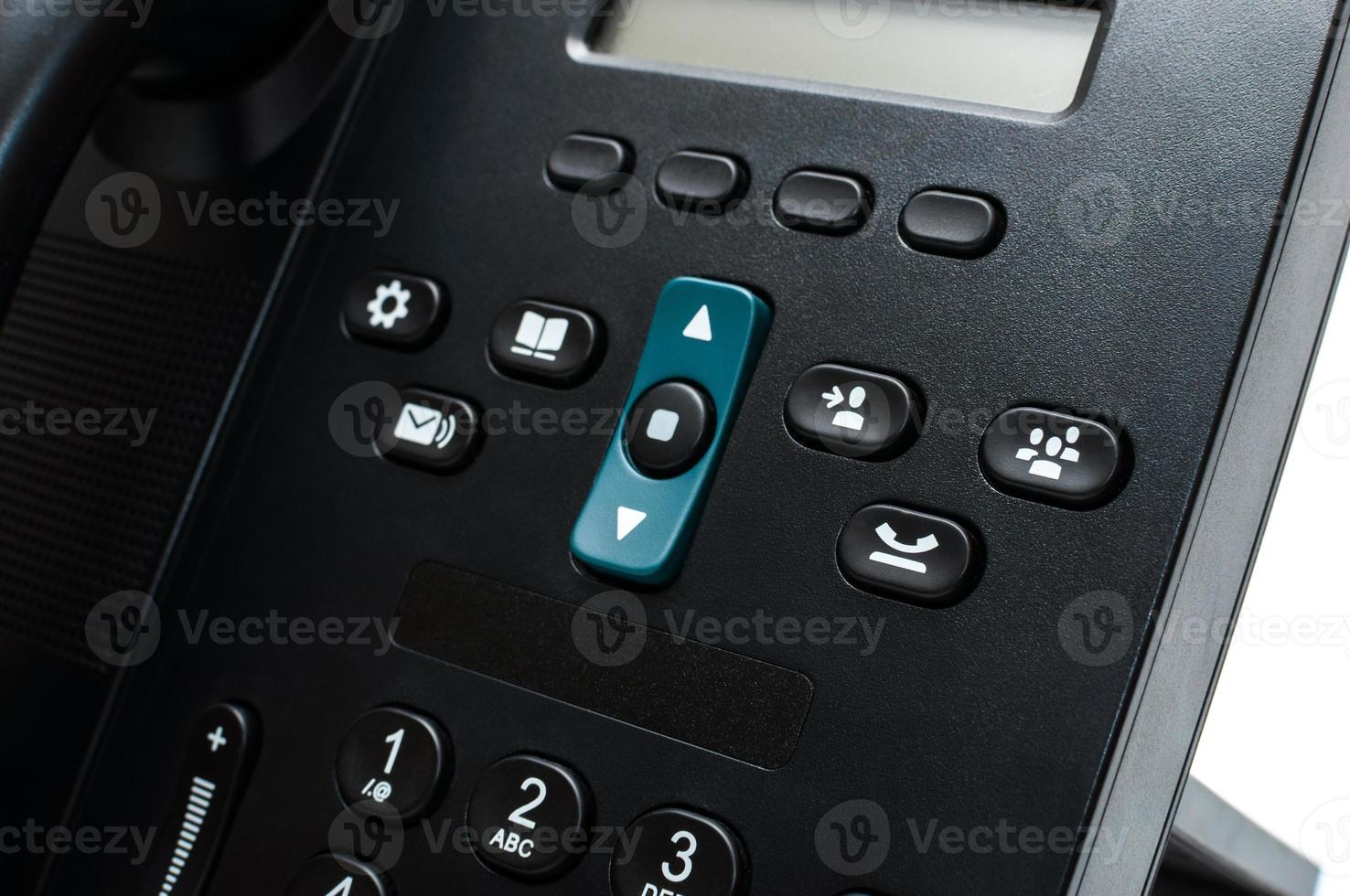 Buttons on a black desk phone photo