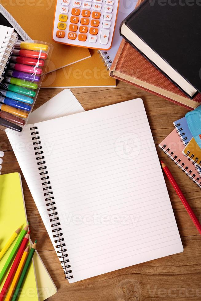 Student desk with blank writing book, copy space photo