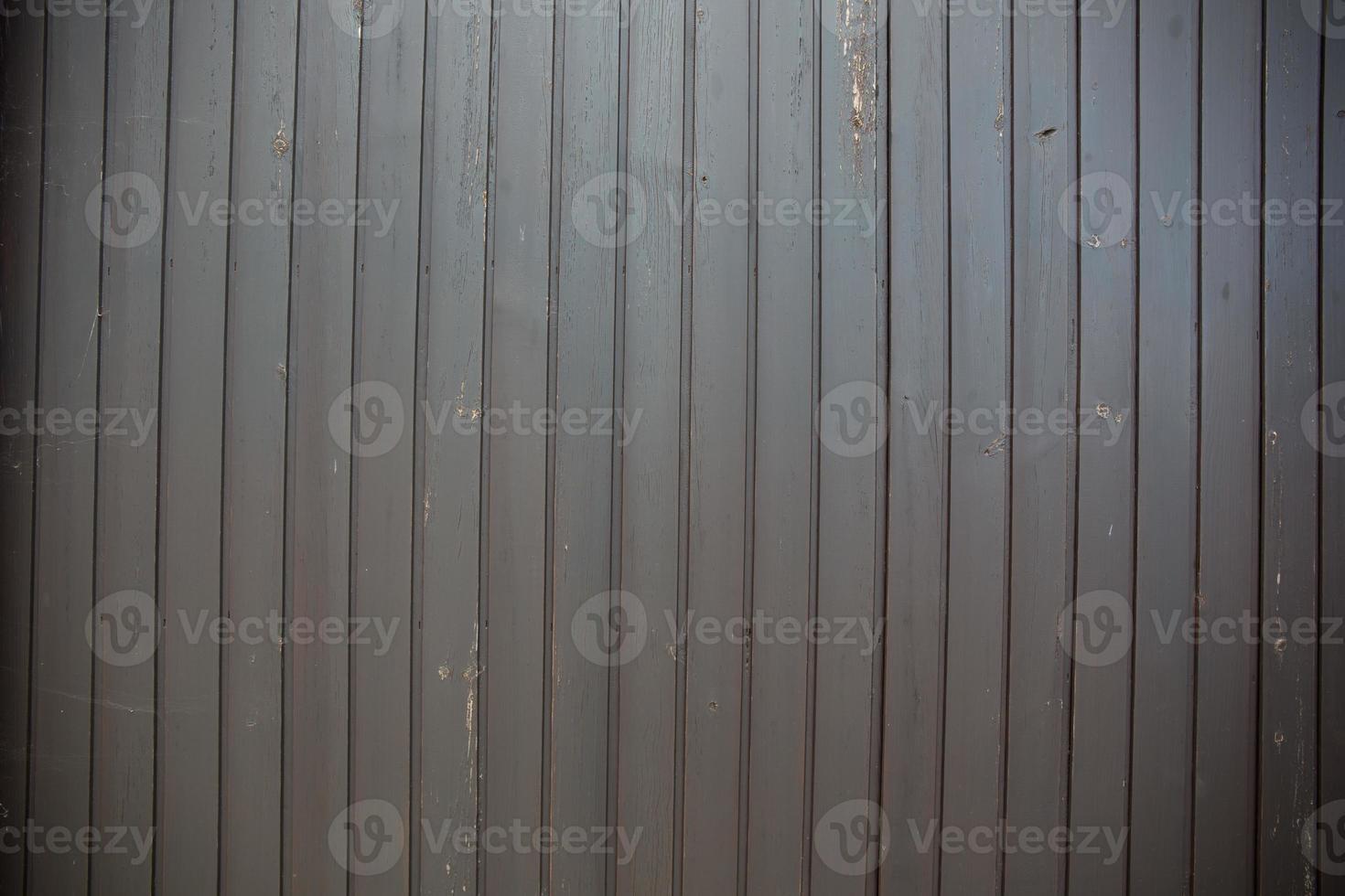 Dark grey wooden background and grunge photo