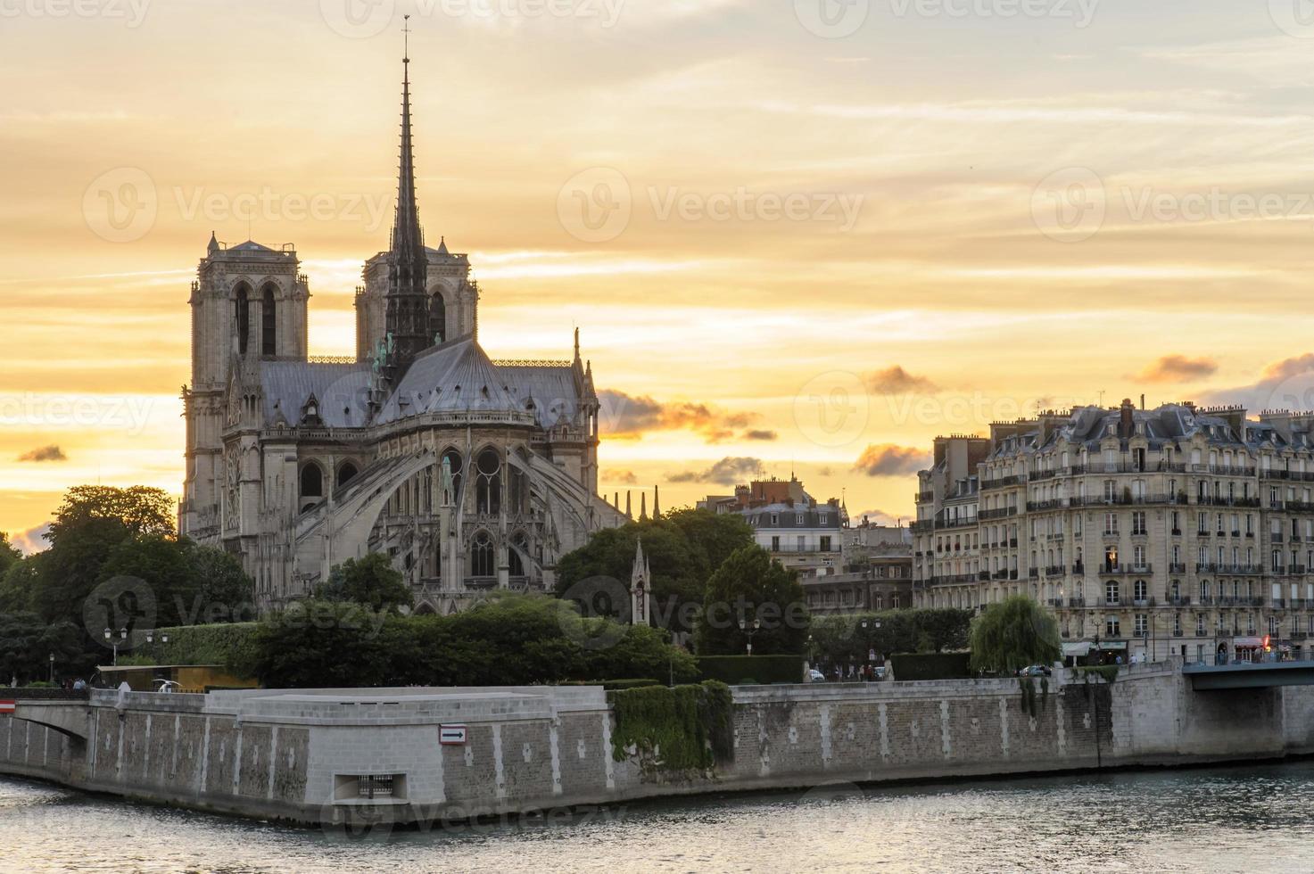 night view of Notre Dame de Paris Cathedral photo