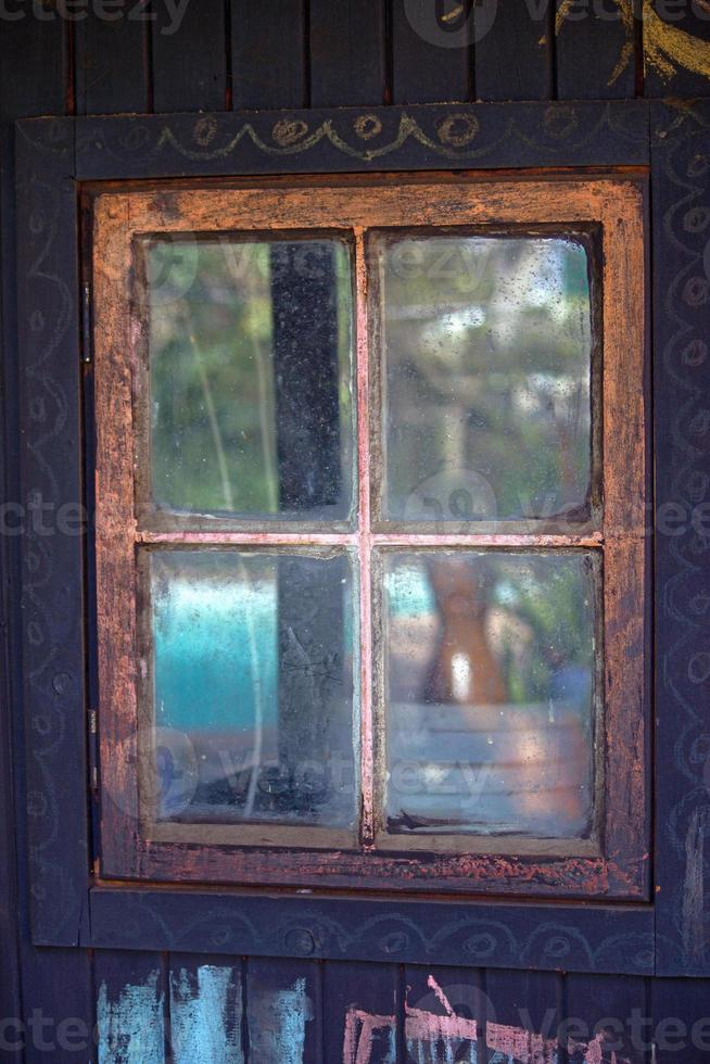 Four pane wooden window in  wall photo