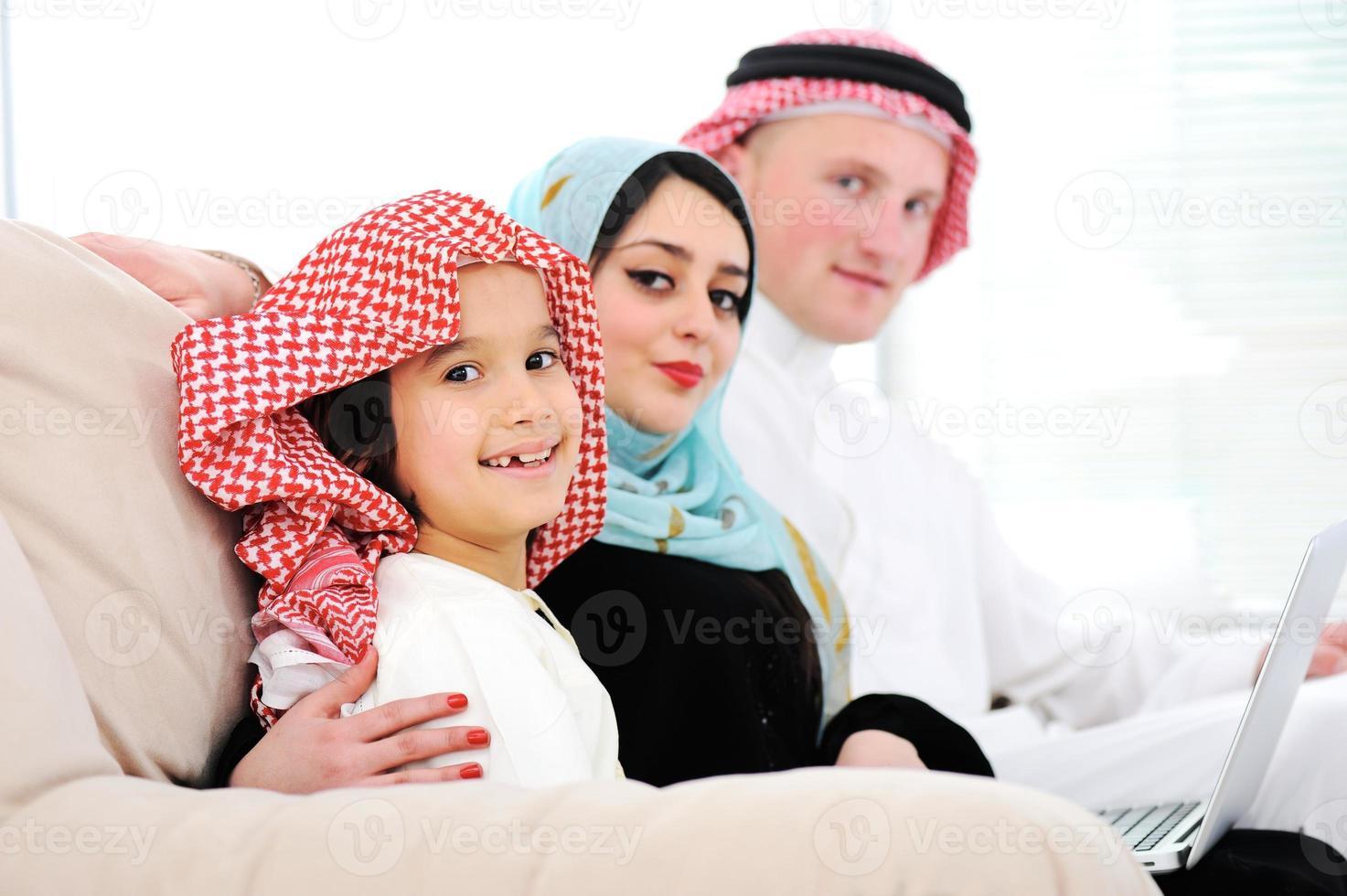 Arabic happy family at home photo