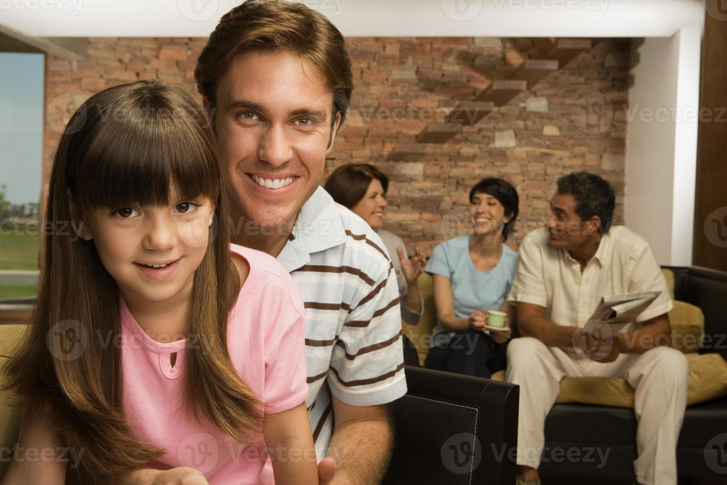 Girl and father with family photo